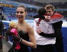 Elena Ilinykh and Nikita Katsalapov of Russia leave the ice after competing in the team free ice dance figure skating competition at the Ice...