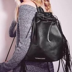 """Victoria Secret Fringe Faux Leather Bag Brand New with Tags! Drawstring bag from Victoria's Secret. Fun fringe detail and silver lettering. Measurements are 16' L x 6.3"""" W x 14"""" H. Victoria's Secret Bags Backpacks"""