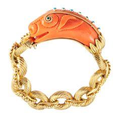 VAN CLEEF & ARPELS Coral Dragon Bracelet   From a unique collection of vintage link bracelets at http://www.1stdibs.com/jewelry/bracelets/link-bracelets/
