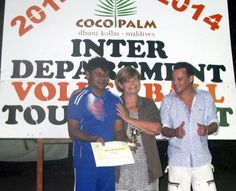 Abdulla Saeed from the Front office team receives his Top Player medal from Martine and Denis.