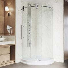 """VIGO Experience the difference of true contemporary design with this frameless sliding round glass shower door enclosure and base. This model is a variation on the classic shower door enclosure, bringing modernity into any bathroom. It is constructed of 5/16"""" ANSI Z97.1 and 16 CFR 1201-certified clear tempered glass, resisting dangerous shards and unsightly streaks. The glass is pre-drilled for the easy installation of a vertical bar door handle. This model has a fixed panel with a left-side sli Corner Shower Kits, Corner Shower Enclosures, Frameless Shower Enclosures, Bathroom Shower Doors, Glass Shower Doors, Shower Base, White Shower, Modern Shower, Hardware"""