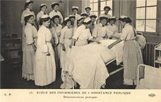 Nurses learn how to make a patients bed, Paris, ca. 1910. Pictures of Nursing: The Zwerdling Postcard Collection. National Library of Medicine