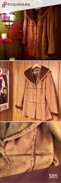 """Dennis Basso Faux Shearling Coat New! Never worn! One of Dennis Brasso's biggest selling coats and you can see why.. it has the look and feel of real with amazing workmanship. The size is large. The info on the materials used is in the picture of the tag. This is a mid length coat and is 20"""" from under arm to the bottom. 25"""" across the chest from pit to pit. Dennis Basso Jackets & Coats Pea Coats"""
