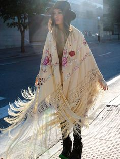 Pretty fringed kimono with floral embroidery detail. Boho chic for fall.