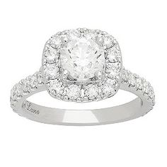Created by designer to the stars, Hollywood's Neil Lane, this breathtaking engagement ring is crafted in platinum and features a round cut diamond in a cushion shaped double halo, set upon diamond encrusted shoulders, totalling 1.90ct. Utterly captivating