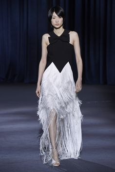 Black velvet racer front dress with white fringe high-low skirt at Givenchy Fall RTW 2018 Paris Fashion Week