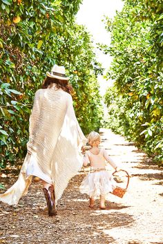 Mother and daughter walking together down an outdoor pathway