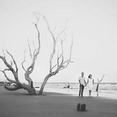 Bull Island, SC engagement session. | Black and white engagement portrait on the beach near Charleston, SC. | Photo by @billiejojeremy #engagementphotographer #charleston #beach #boneyard #charlestonphotography #love #engaged #engagement # portraits #naturallightphotography #whitedress
