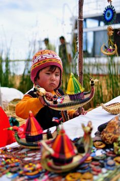 You'll find these cute little handcrafted boats on Uros island, Peru. (Lake Titicaca)