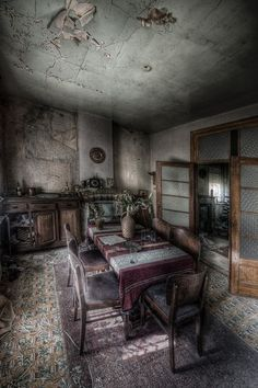 velvetbambi:    where did the people go?! The table is still set .. how is it that these places remain as relics of what once was .. I can almost see the memories embedded in this photograph..