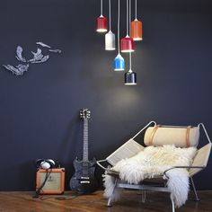 """I love the recycling aspect of these spotlights, made from repurposed fire extinguisher tanks painted with high-gloss automotive paint.. But the price each, at $440? Please. I'm already thinking """"I could make something like that.""""  #pendant #lighting #recycling"""