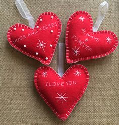 3 felt Christmas decorations. Hearts - approx 12 cm wide at widest and 11.5cm high All hand made and embellished with glass bead and embroidery floss as shown in pictures.