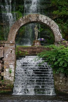 Hidden next to the River Eden at Great Corby is a secret garden, where a statue of Lord Nelson over sees a waterfall.  (near Carlisle, England)