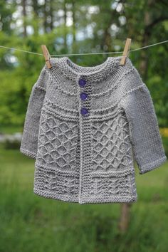 Coming Home Cardigan is knit seamlessly from the top down. The delightful blend of stitch motifs used are fun and easy to knit. The sweater is conveniently written in 10 sizes ranging from newborn to 10yo. All measurements are given in US and metric.