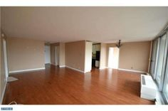 HOME FOR SALE- ENTOURAGE ELITE REAL ESTATE- 3900 FORD ROAD 3A, PHILADELPHIA, PA 19131  LARGEST UNIT IN PARK PLAZA, SPACIOUS CONDO W/FLOOR TO CEILING WINDOWS