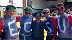 These four Warrior fans demonstrate school spirit with President Elsa Núñez at the Pep Rally in Francis E. Geissler Gymnasium.