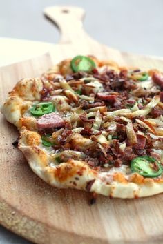 bacon jalapeño sausage pizza with sriracha sauce