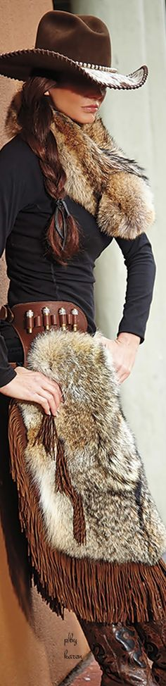 ~ Ever the Diamond Cowgirl: Bobbi Jeen Olson modeling a choco brown felt cowgirl hat with tooled brim and whip stitched trim, fur collar and coyote trimmed & fringed chaps.  This is a side view of the full view pic (center).  Now this is my kinda Western style...slick! ~