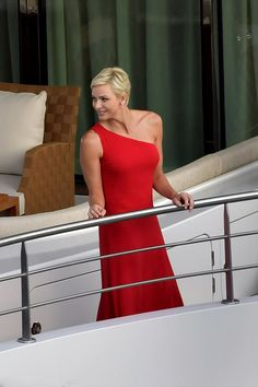 Princess Charlene of Monaco looked ready for the red carpet in a simple yet stunning in a scarlet one shoulder gown as she attends the launch of an ecological expedition ship in Monaco on July 27, 2017