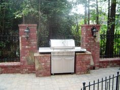 build a brick grill surround | Brick and stone grill surround built into the courtyard walls.