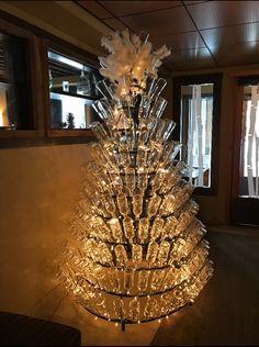 One of our Wine Bottle trees in Hotel Terra Jackson Hole #winebottletree #christmasdecor #Bottleart