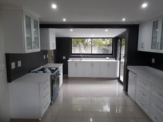 Our Shaker profile doors in white PVC wrap. Creates a clean sophisticated look for the modern kitchen. #kitchen #white #livingspace #modernspace #renovation Kitchen White, Modern Spaces, Living Spaces, Kitchens, Kitchen Cabinets, Profile, Doors, Home Decor, User Profile