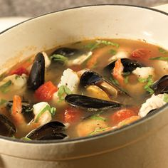 Mediterranean Fish Soup! This is a quick and easy recipe that's perfect for a cool winter day. I might just add some shredded carrots with the onions and a pinch of saffron near the end. A little crustini is a must for dipping--and don't forget to use the mussel shells as a spoon. No utensils required. -CanCan