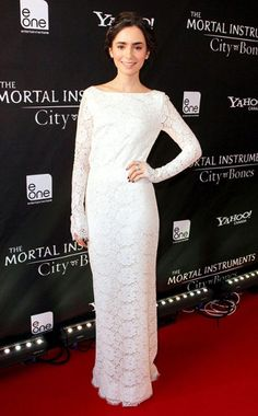 Lily Collins looks lovely in lace with this all-white Houghton gown. #fashion