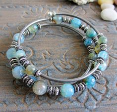 Hey, I found this really awesome Etsy listing at https://www.etsy.com/listing/190038414/agate-bracelet-blue-and-silver-triple