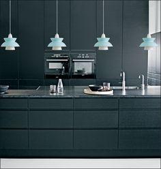 Blue Louis Poulsen 'Doo-Wop' pendant lights hung in a charcoal-coloured kitchen