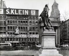 Union Square, Manhattan.  Looking up at statue of Lafayette from behind and left, S. Klein's Store, a bank, a hotel, and the Consolidated Edison Building beyond.  Berenice Abbott, NYPL digital archives.  NYC vintage photo.  March 20, 1936.
