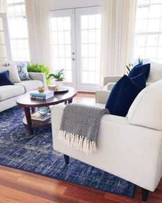 Blue and white living room with blue vintage distressed rug and modern coastal vibe for a happy home #homedecor #bluedecor #livingroom #livingroomdecor #coastaldecor #moderndecor