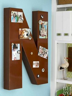 Purchase an oversize metal letter new or from a thrift store. Sand and paint in the color of your choice. Hang, and use magnets to display photos and messages.