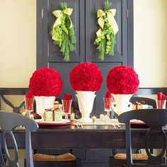 Front and Center- This tabletop take on pomander balls makes an eye-catching display. Simply soak florist's foam balls in water and cover with red carnations. Place the finished balls atop white vases or urns placed in a row along the center of your table.