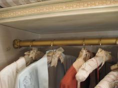 The hangers in a guest room closet are covered in a custom silk check fabric, with bugs embroidered by Jean Francois Lesage.  New York apartment of Howard Slatkin. Rod also designed by Slatkin, made by P.E. Guerin.