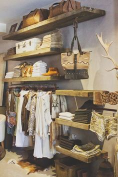 Love the rustic wood shelves. We'll have pretty prop storage like this one day. Minus the antlers: