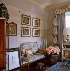sitting room with old documents on wall & gilt framed art, blue and white print settee ~ Mimmi O'Connell