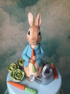 Learn how to create a Peter Rabbit figurine out of modeling chocolate with this tutorial; perfect for a Peter Rabbit themed cake. Peter Rabbit Figurines, Peter Rabbit Cake, Peter Rabbit Birthday, Peter Rabbit Party, Fondant Rabbit, Baby Boy Birthday Cake, 3rd Birthday, Camo Wedding Cakes, Miniatures