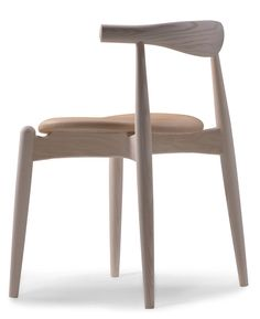 Timeless elegance. The beautiful wooden CH20 chair by Hans Wegner for Carl Hansen & Son.