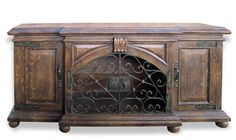 This hand painted old world sideboard has wrought iron and features a one middle shelf interior.   See more of our alluring Tuscan furniture and accessories online at www.KoenigCollection.com!