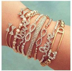 Love these! Especially the little bow bangles up at the wrist!!!