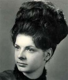 my mom always sported the beehive...thank GOD she outgrew THAT.