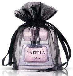 """La Perla """"J'Aime""""--Bergamot, pepper and litchi open the composition. Intense Egyptian jasmine in the heart, which sounds almost animalisticly sensual, finds itself in the company of lotus and raspberry. As it develops, the fragrance becomes sweeter and darker, as musk, caramel, amber and patchouli come to the scene."""