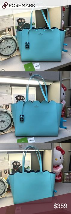 Kate Spade Lily Avenue Scallop Bag, Tiffany Color Excellent Condition. Only have had  and carried for 3 weeks. No stains or tears. Smoke free home! Have the tags. Measures approximately 11.1 (h) x 13.1 (w) x 5.3 (D) . Double Straps with a 9.5 inch drop. The color is almost Tiffany Blue color. Atoll Blue/ Oceanic Blue Color! The pockets are on the front as in pictures for easy carry of phone, keys, etc. 100% authentic. Zip closure, 100% cow leather. Smooth leather.  No trades!!! 😍last pic is…
