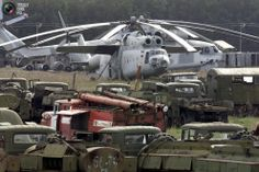 Contaminated helicopters and machinery that were used to fight the fire at the Chernobyl nuclear plant rust in Rossoha inside the 30-km exclusion zone set around the plant in this April 21, 2001 file photo.