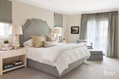 Calm Master Bedroom with Neutral Fabrics and Headboard
