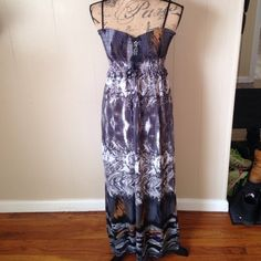 Maxi dress Front strings can be tightened to create a lower cut or left loose to fit straight across your chest. Perfect for summer. Black straps are adjustable. Dresses Maxi
