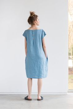 PLEASE KEEP IN MIND that the dress is of rather loose fit designed to have a loose/roomy look. But we noticed that there are some part of customers who like more fitted look, so if you want the dress not to be baggy and loose you may definitely go size down and still will look good! Washed an soft linen loose dress with decorative buttons in the back for comfortable fit. The model is 172 cm high and custom length to 115 cm is available with no extra charge. Please let us know your wishe...