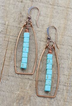 Unique geometric, antiqued copper hoops withdangles made of blue turquoise magnesite cubes. Very light weight and approx 2 in length.