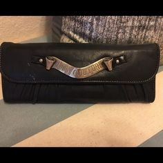 Juicy Couture black leather wallet Very cute, but edgy Juicy Couture wallet. It is black with silver hardware. It is very soft leather. It has some worn marks, but in pretty good condition. Juicy Couture Bags Wallets